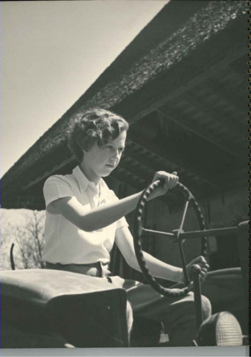 Ma at helm of tractor