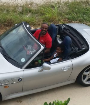 Uncle Mel and I in his new car